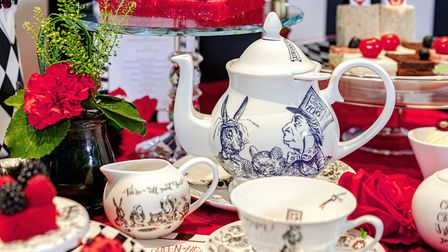 Tea is served in crockery inspired by John Tenniel's Alice illustrations