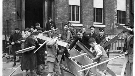 Pupils return to Portsmouth Grammar to help rebuild the school following bomb damage in 1945