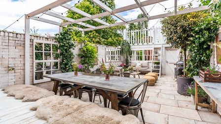 Garden as outside room and ultimate entertaining space, including mirrors that are upcycled window f