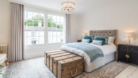 There's a maritime feel to this boutique bedroom with wooden traveller's trunk, lacquered chest and