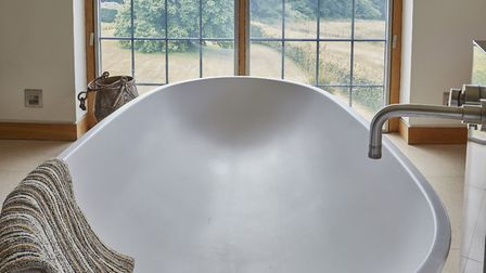 The Philippe Starck 'spoon' bath. Image: Mark Ashbee / Unique Homestays