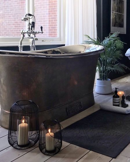 Philippa splashed out on this bath which sits in the couples bedroom. The extra special tub with its