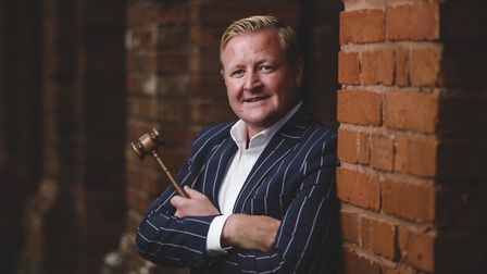Auctioneer Scott Gray loves it when the gavel comes down: 'You think: brilliant. That's done. Let's