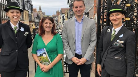 Chester BID team under Eastgate Street looking on the main high street: Luka Morrell (City Host), Em