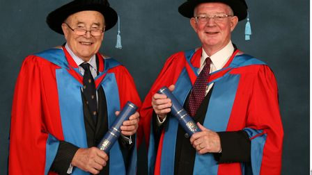 Professor Robin Ling, left and Dr Clive Lee receiving their honorary degrees from Exeter University