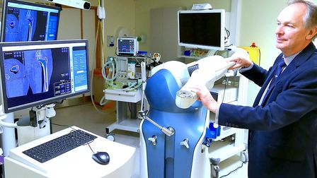 Orthopaedic surgeon, Prof John Timperley demonstrates how the Mako robotic arm is used at the Exeter