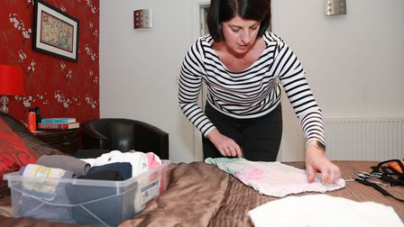 Lesley in action demonstrating the smart way to file your t-shirts.