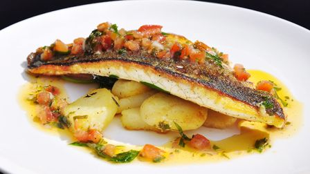 Seared sea bass fillet with spinach, new potatoes and sauce vierge at Herons, Chorleywood (photo: Br