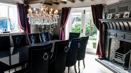 The dining room is in the original 17th century house, where the wooden beams and fabulous fireplace