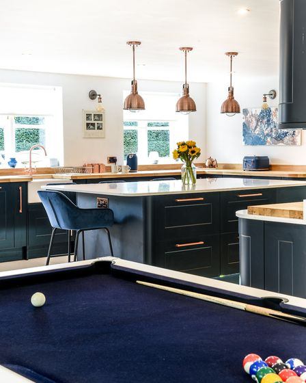 As family gathering spaces go, a pool table next to the kitchen is a stroke of genius. The blue felt