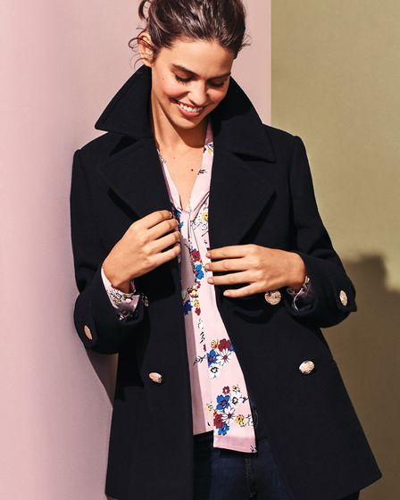 M&S Collection Pea Coat £79.00, Floral Blouse £29.50, Ivy Jeans £25.00. Image: Marks & Spencer