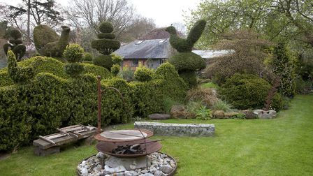 Topiary creatures emerge from the curvaceous hedging