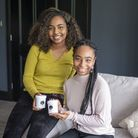 Sisters Iman and Yasmine with their brand-new haircare product