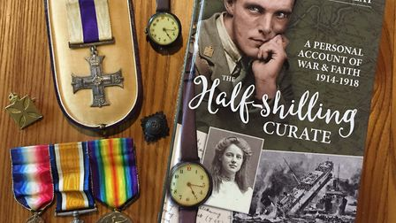 Sarah Reay's biography of her grandfather alongside his medals (photo courtesy Sarah Reay)