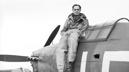 Squadron Leader Douglas Bader, seated on a Hurricane in September 1940. The following year he'd be s