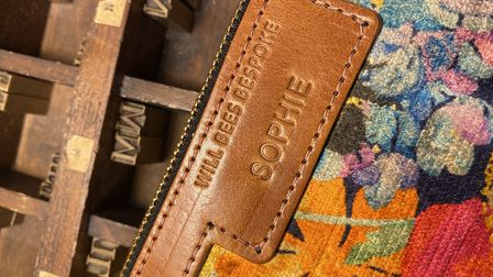 Handbags are embossed with the name or initials of the recipient for a personal finish. Photo: Will