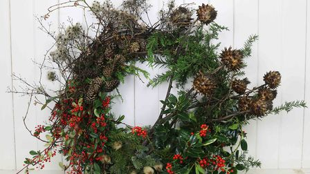 Winter berries add colour to this wreath