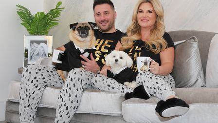 Relaxing at home. Nicole and her husband Joe, with adored pooches Junior and Glenn.