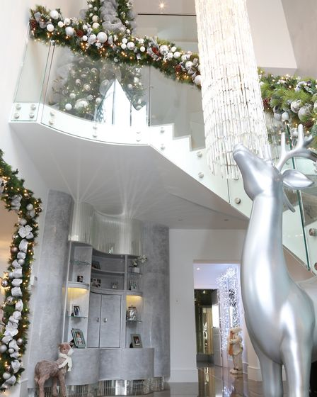 The chandelier cascades from the upper level of the house, and Nicole has sufficient extra cystals t