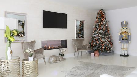 While the Christmas colour palette throughout Nicole's home unites silver, white and green, the addi