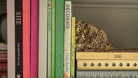 Organising books by size or colour will give a professional look to your interiors