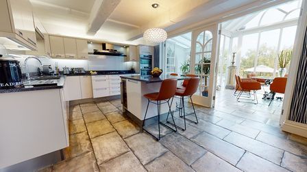 A smart kitchen leads to beautiful orangery-style dining room (photo courtesy Elliott James Prime Residential)