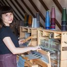 Weaver-in-residence Rosie Green at one of the Harris looms upstairs in The Granary
