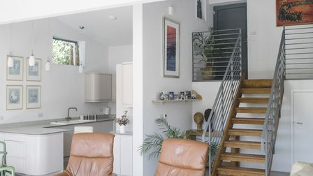 The central staircase leads down to the bright and open plan living room, dining room and kitchen. P
