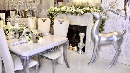 Brushed silver with creams and natural greens adorn Adele's dining room