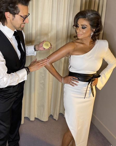 Armand applies Pro Body Glow for a finishing touch before Shobna walks the red carpet