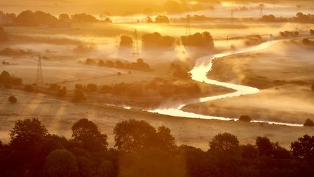 Morning sun shining over South Downs National Park and Ouse River