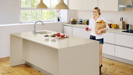 Warm beiges teamed with wood will add a cosy feel to your kitchen. Picture: Cosentino