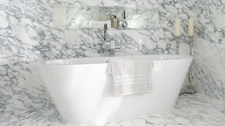 Use light-toned or white marble to make a smaller bathroom appear larger. Picture: stoneCIRCLE