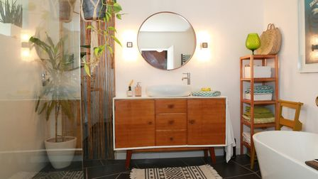 Emma converted the original master bedroom to a family bathroom, taking out the bay window and using