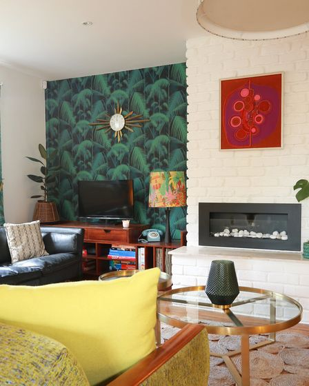 Mixing the current trend for bold colours and patterns in wallcoverings with her collection of mid-c