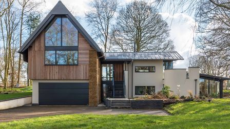 Long House - a contemporary, highly-insulated and energy-efficient home within a woodland glade. Pic