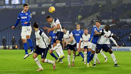Brighton and Hove Albion's Joel Veltman (left) attempts a shot on goal during the Premier League mat