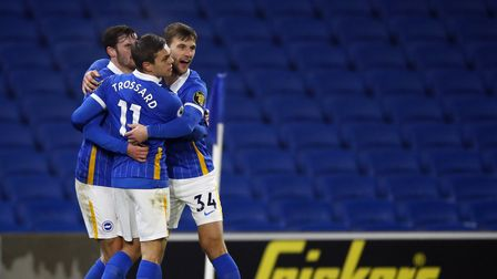 Brighton and Hove Albion's Leandro Trossard (centre) celebrates scoring their side's first goal of t