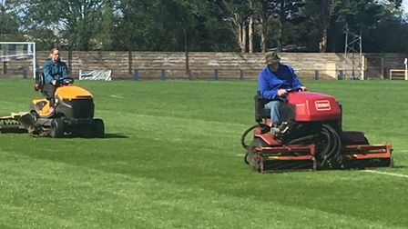 Sam and Jon Hibbs work on the Clevedon Town pitch