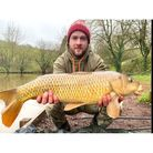 Liam O'Connor with a common carp from Newbarn