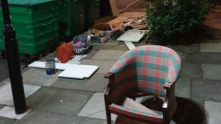 Chairs and sofas have been disposed on the street