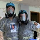 Two hospital staff wearing full PPE