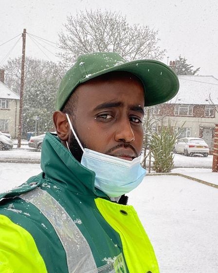 Ambulance driver pictured in snow.
