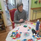 Residents havepaintedpebbles and decoratedthem with positive messages and thoughtswithwords such as wellness...