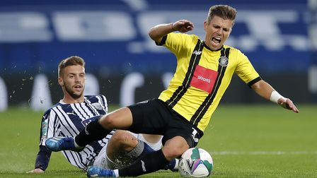 West Bromwich Albion's Sam Field (left) and Harrogate Town's George Thomson battle for the ball duri