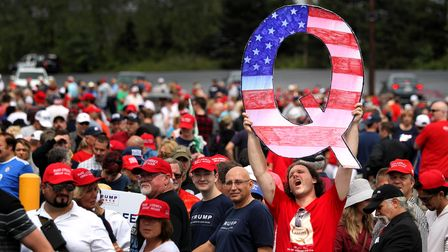 A 'Q' sign, representing QAnon, is held up at a Trump rally in Pennsylvania