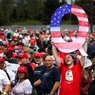 A 'Q'sign, representing QAnon, is held up at a Trump rally inPennsylvania