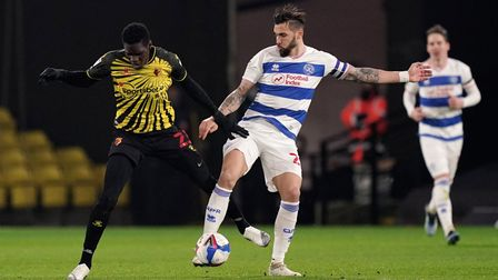 Watford's Ismaila Sarr and Queens Park Rangers' Geoff Cameron (right) battle for the ball during the