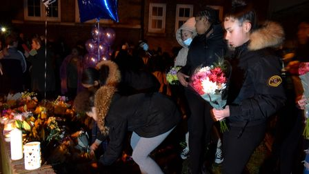 Community vigil for Romario Opia on Holland Walk 01.02.21.Young people with flowers