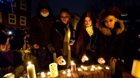 Community vigil for Romario Opia on Holland Walk 01.02.21.Young people lay candles on the wall